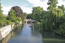 A wonderfully peaceful scene as a punt glides down the River Cam at Cambridge